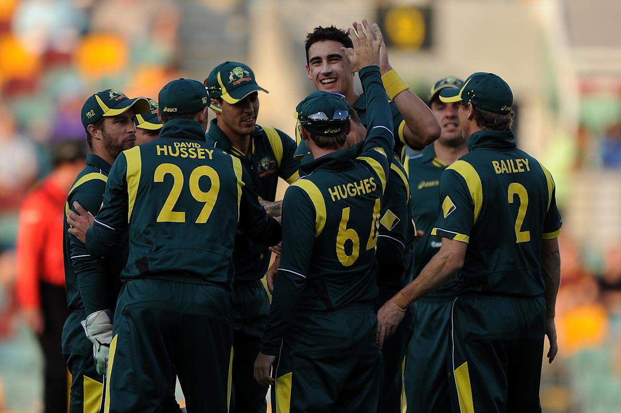 BRISBANE, AUSTRALIA - JANUARY 18:  Mitchell Starc (C) of Australia celebrates a wicket during game three of the Commonwealth Bank one day international series between Australia and Sri Lanka at The Gabba on January 18, 2013 in Brisbane, Australia.  (Photo by Matt Roberts/Getty Images)