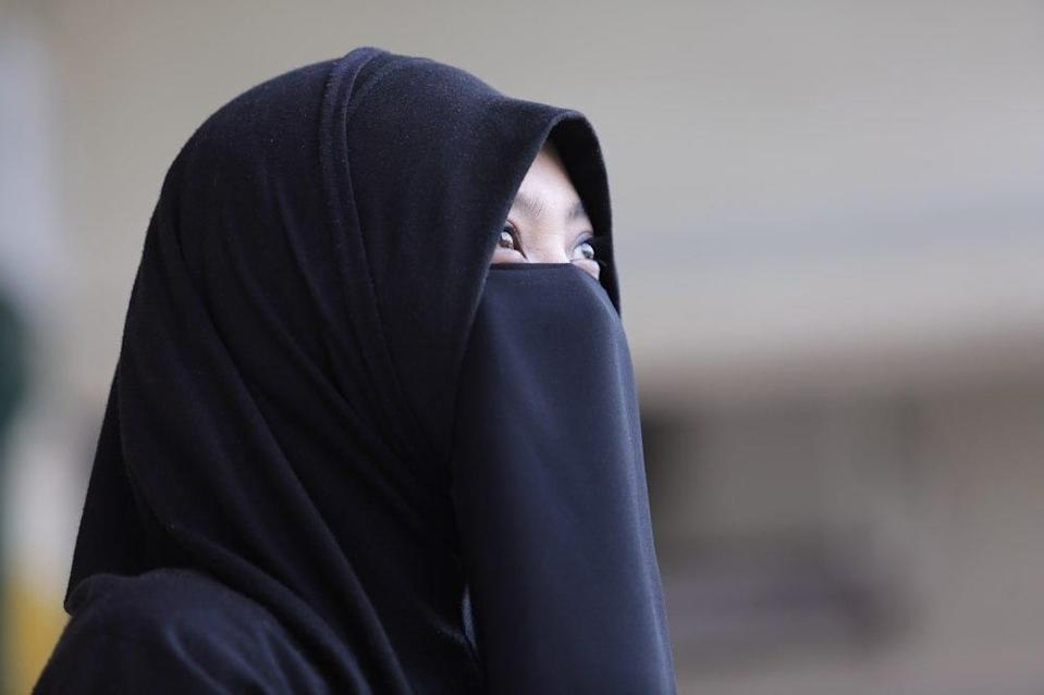 File picture of a woman wearing a niqab in Shah Alam October 3, 2014. — Picture by Choo Choy May