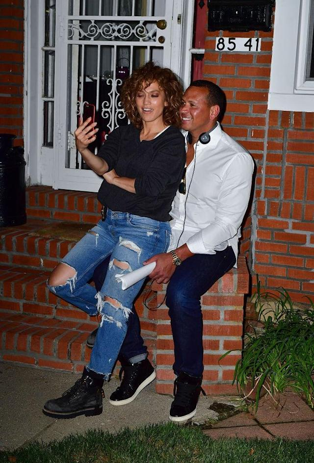 <p>On location for J.Lo's show <em>Shades of Blue</em>, the pair was spotted taking selfies in laid-back denim looks. (Photo: Getty Images) </p>