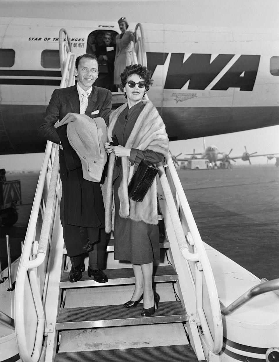 <p>Legendary singer Frank Sinatra and Academy Award nominee Ava Gardner (<em>Mogambo</em>, <em>Show Boat</em>) board an airplane. The couple shared a tumultuous and <em>very</em> public marriage that lasted from 1951 to 1957. </p>