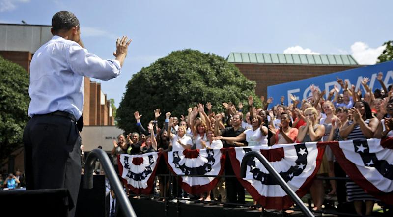 President Barack Obama turns around and waves to the supporters standing behind the stage during a campaign event at Norfolk State University, Tuesday, Sept. 4, 2012, in Norfolk, Va. (AP Photo/Pablo Martinez Monsivais)