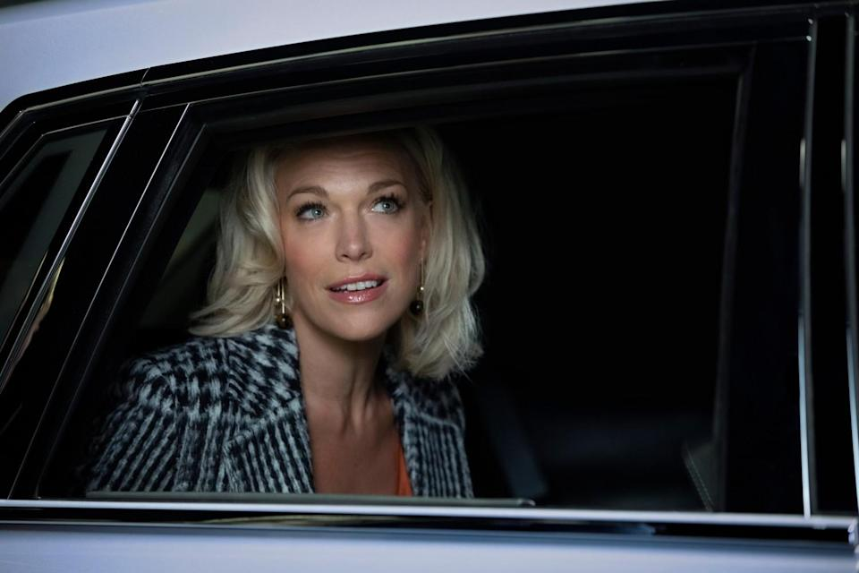 """Hannah Waddingham peers out a car window in a scene from """"Ted Lasso."""""""