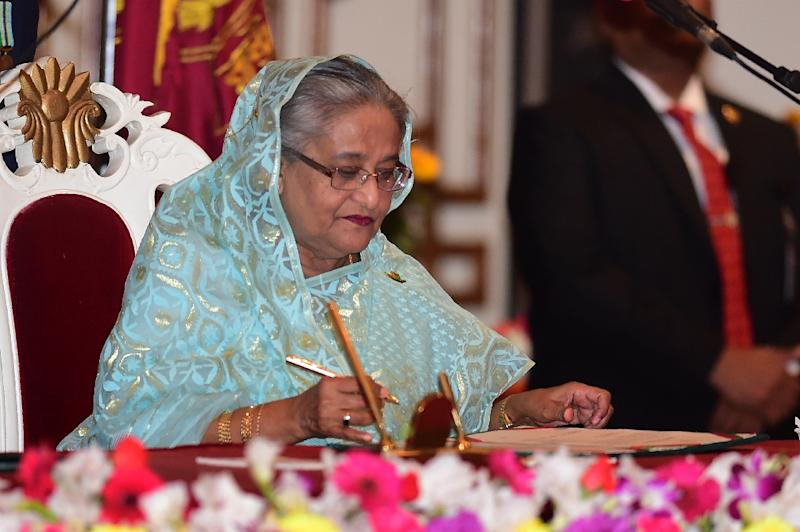 Sheikh Hasina signs documents after being sworn in for her fourth spell as Bangladesh's prime minister (AFP Photo/Munir UZ ZAMAN)
