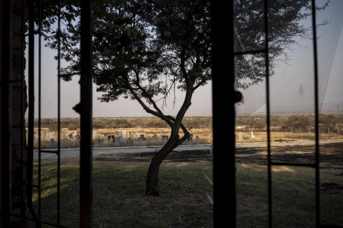 The cemetery where where the body of 12-year-old Onthatile Mohapi is buried in Damonsville, South Africa, is seen in this June 8, 2020 photo. Mohapi's body was found in a dam 7 kilometers from his home. The pathology report said the boy drowned, but his mother believes he was murdered. (AP Photo/Bram Janssen)