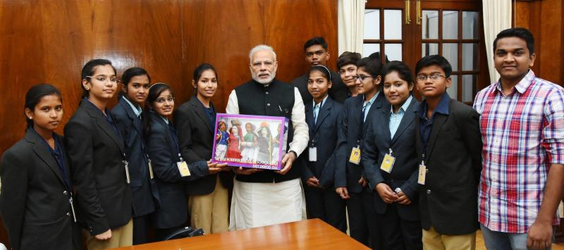PM Modi with a group of students and teachers