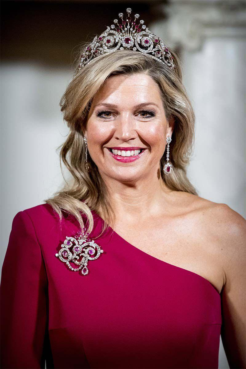 <p>Queen Maxima of The Netherlands kept her hairstyle simple with beachy waves and a deep side part so her diamond and ruby crown could really steal the show. </p>