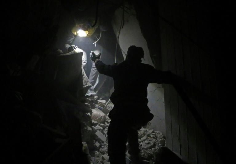 Syrian rescuers work in the battered rebel enclave Eastern Ghouta on February 22, 2018