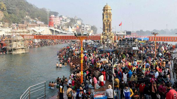 PHOTO: Hindu devotees gather to take a holy dip in the waters of river Ganges to mark 'Makar Sankranti' festival, which falls on the first day of the religious Kumbh Mela, or 'festival of the pot.'  (Stringer/Reuters)