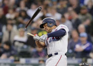 Minnesota Twins' Jonathan Schoop breaks a bat on a Seattle Mariners pitch during the fourth inning of a baseball game, Saturday, May 18, 2019, in Seattle. Schoop grounded out on the at-bat. (AP Photo/John Froschauer)