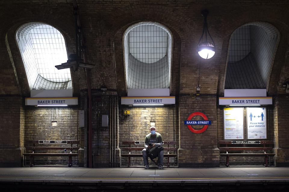 A man wearing a face mask in Baker Street Tube station in London (Victoria Jones/PA) (PA Wire)