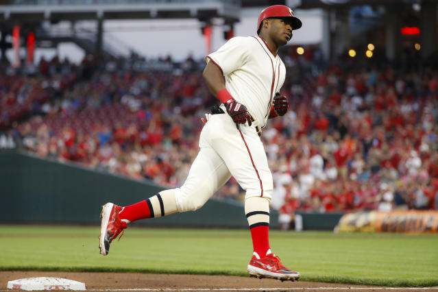 Cincinnati Reds' Yasiel Puig runs the bases after hitting a two-run home run off Texas Rangers starting pitcher Mike Minor during the fourth inning of a baseball game Saturday, June 15, 2019, in Cincinnati. (AP Photo/John Minchillo)