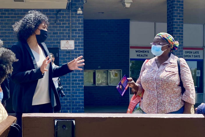 Image: NYC mayoral candidate Dianne Morales speaks with a local resident in the Bronx, N.Y. (Nicole Acevedo / NBC News)