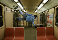 Dance instructor Rodolfo Robles rehearses in a subway car while traveling to a friend's house to prepare for a performance, in Santiago, Chile, Tuesday, Sept. 21, 2021. (AP Photo/Esteban Felix)