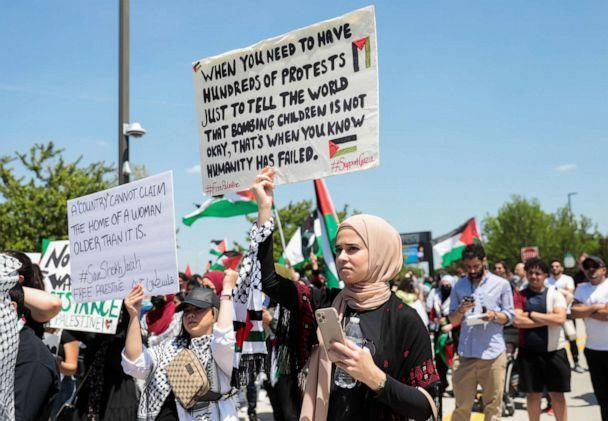 PHOTO: A woman holds a sign during a pro-Palestinian protest in Dearborn, Mich., May 18, 2021. (Rebecca Cook/Reuters)