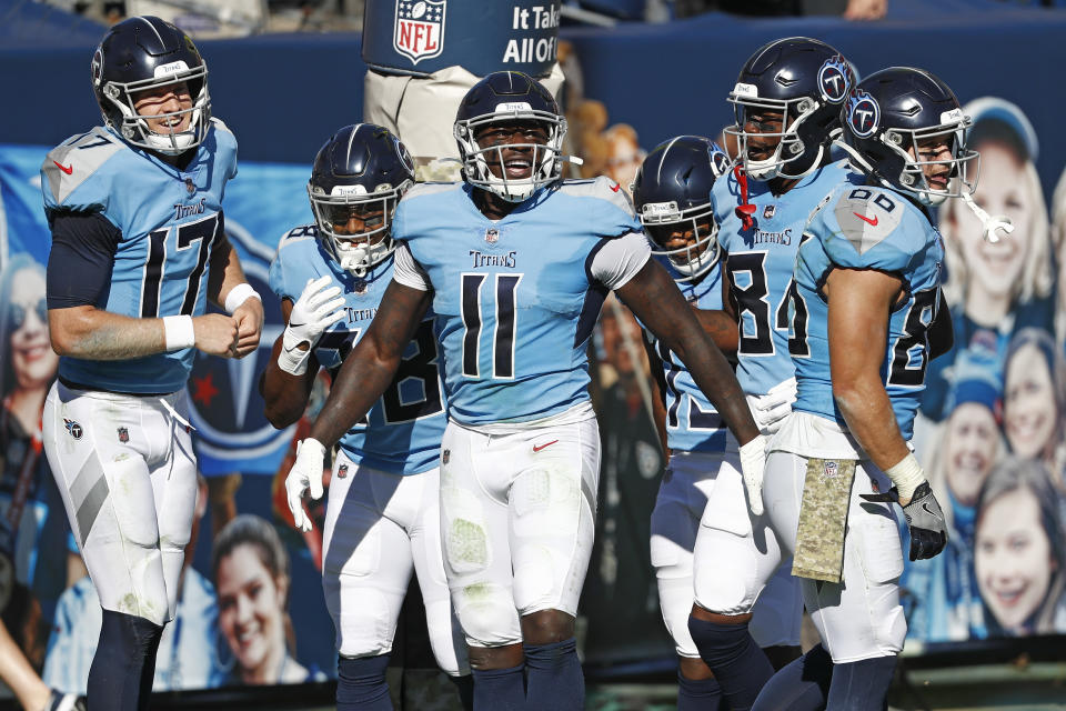 Tennessee Titans wide receiver A.J. Brown (11) celebrates with quarterback Ryan Tannehill (17) after they teamed up for a 40-yard touchdown pass. (AP Photo/Wade Payne)