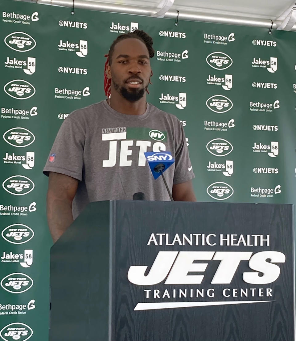 New York Jets linebacker C.J. Mosley speaks to reporters at the team's NFL football training camp facility in Florham Park, N.J., Tuesday July 27, 2021. (AP Photo/Dennis Waszak Jr.)