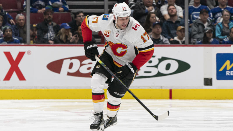 VANCOUVER, BC - FEBRUARY 08: Milan Lucic #17 of the Calgary Flames skates with the puck in NHL action against the Vancouver Canucks at Rogers Arena on February 8, 2020 in Vancouver, Canada. (Photo by Rich Lam/Getty Images)