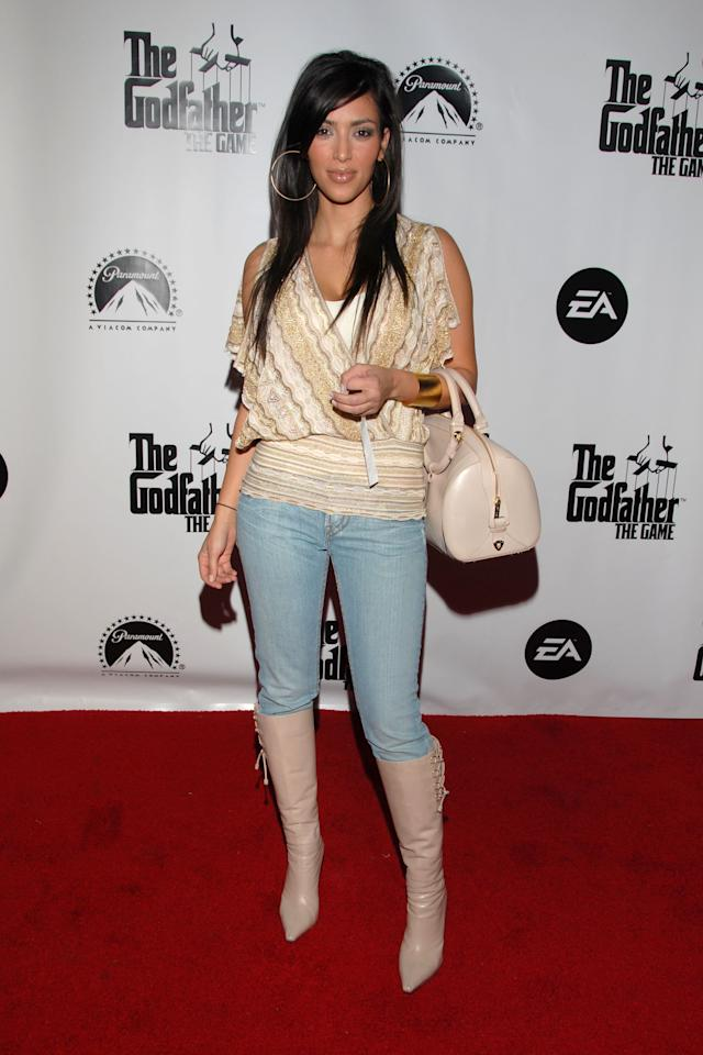 """Back in 2006, a then 26-year-old <strong>Kim Kardashian </strong>attended the premiere of """"The Godfather - The Game"""" launch in Hollywood. She chose to wear skinny jeans, a deep-V sweater, and giant gold hoop earrings."""