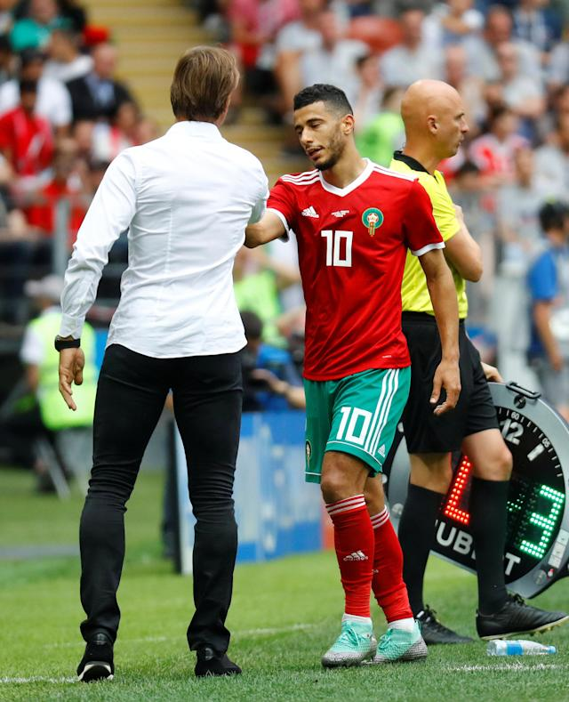 Soccer Football - World Cup - Group B - Portugal vs Morocco - Luzhniki Stadium, Moscow, Russia - June 20, 2018 Morocco's Younes Belhanda shakes the hand of Morocco coach Herve Renard REUTERS/Kai Pfaffenbach