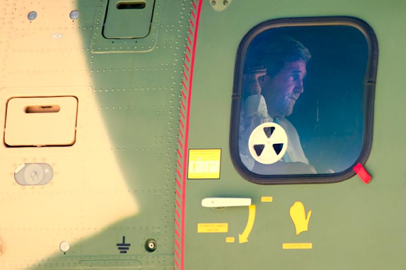 U.S. Secretary of State John Kerry is seen through tinted glass after boarding a Jordanian helicopter in Jerusalem, bound for a meeting with Palestinian President Mahmoud Abbas in Amman, Jordan, on Saturday, June 29, 2013. On his fifth trip to the Middle East, Kerry met with Abbas for the second time in two days as he continues a rushed round of shuttle diplomacy to restart talks between Israel and the Palestinians. He plans to fly back to Jerusalem later in the day for more talks with Israeli officials. (AP Photo/Jacquelyn Martin, Pool)