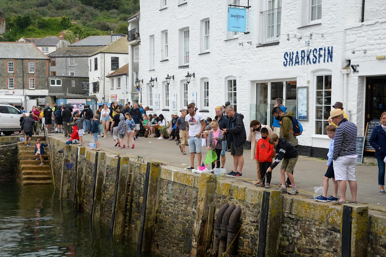 MEVAGISSEY, ENGLAND - JULY 29: Tourists are seen on July 29, 2021 in Mevagissey, United Kingdom. (Photo by Finnbarr Webster/Getty Images)