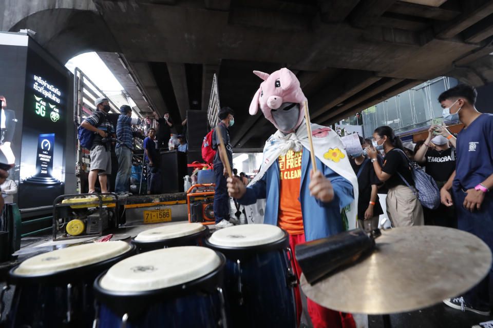 "An individual wearing a mask beats conga drums during a student rally in Bangkok, Saturday, Nov. 21, 2020. Organized by a group that mockingly calls themselves ""Bad Students,"" the rally calls for educational reforms and also supports the broader pro-democracy movement's demands for constitutional change. (AP Photo/Sakchai Lalit)"