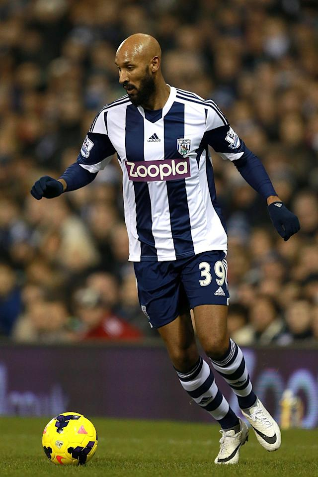 West Bromwich Albion's Nicolas Anelka controls the ball during their English Premier League soccer match against Everton at The Hawthorns, West Bromwich, England, Monday, Jan. 20, 2014. West Bromwich Albion is losing its main sponsor in the fallout from Nicolas Anelka celebrating a Premier League goal with a gesture considered to be anti-Semitic (AP Photo/PA, David Davies)