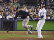 Boston Red Sox's Rafael Devers hits a RBI-single off Los Angeles Dodgers relief pitcher Dylan Floro during the ninth inning in Game 4 of the World Series baseball game on Saturday, Oct. 27, 2018, in Los Angeles. (AP Photo/Mark J. Terrill)