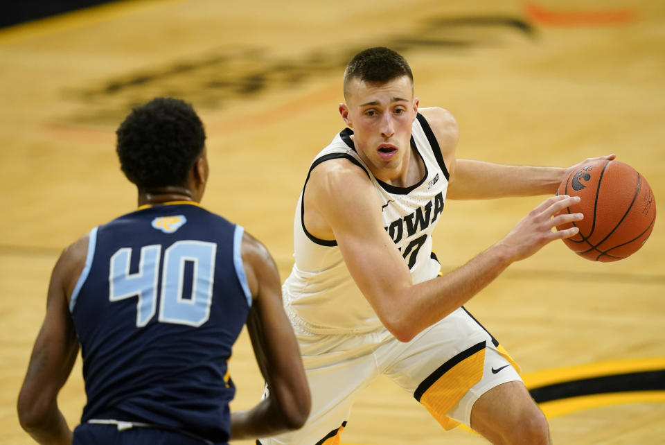 Iowa guard Joe Wieskamp drives to the basket in front of Southern University's Damiree Burns (40) during the second half of an NCAA college basketball game, Friday, Nov. 27, 2020, in Iowa City, Iowa. Iowa won 103-76. (AP Photo/Charlie Neibergall)
