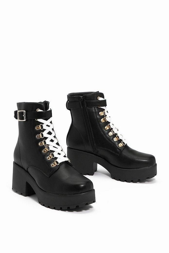 "<br><br><strong>Nasty Gal</strong> Give 'Em the Boot Chunky Boot, $, available at <a href=""https://go.skimresources.com/?id=30283X879131&url=https%3A%2F%2Fwww.nastygal.com%2Fgive-em-the-boot-chunky-boot%2FAGG85862.html"" rel=""nofollow noopener"" target=""_blank"" data-ylk=""slk:Nasty Gal"" class=""link rapid-noclick-resp"">Nasty Gal</a>"
