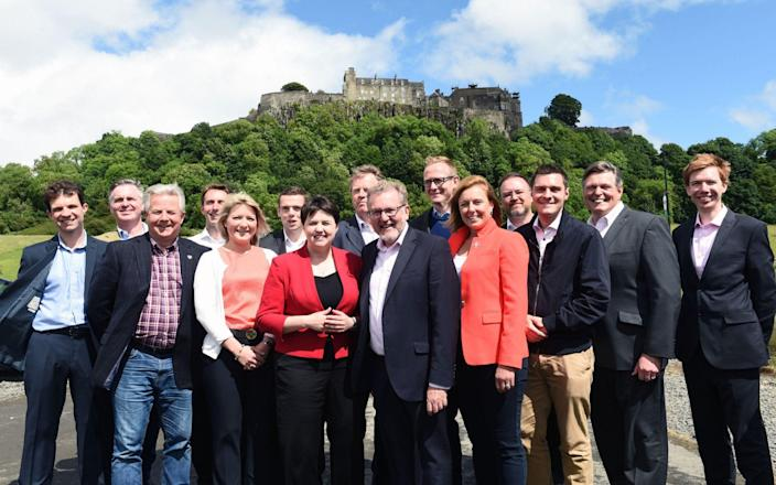 Mr Clark, second from the left, along with Ms Davidson and Mr Mundell in 2017 - Lesley Martin/PA