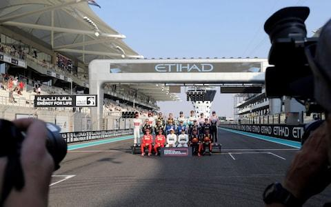 Drivers pose during an end season picture ahead the Emirates Formula One Grand Prix, at the Yas Marina racetrack in Abu Dhabi, United Arab Emirates, Sunday, Dec.1, 2019 - Credit: AP