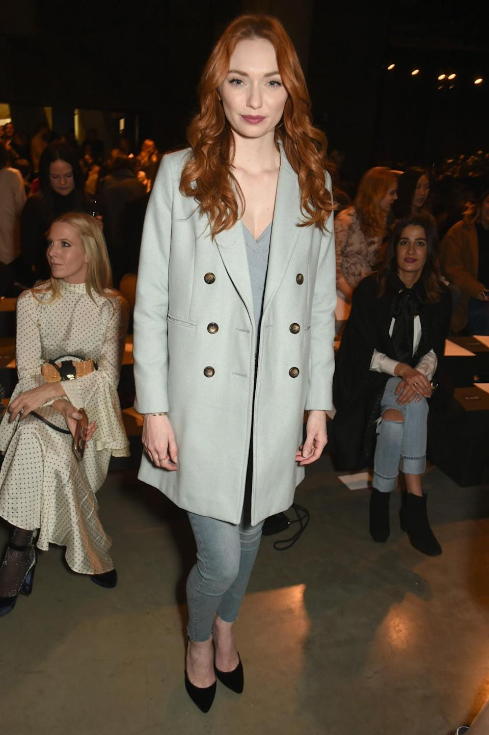 <p>Poldark actress Eleanor Tomlinson attended in a button-up coat and jeans. <i>[Photo: Getty]</i> </p>