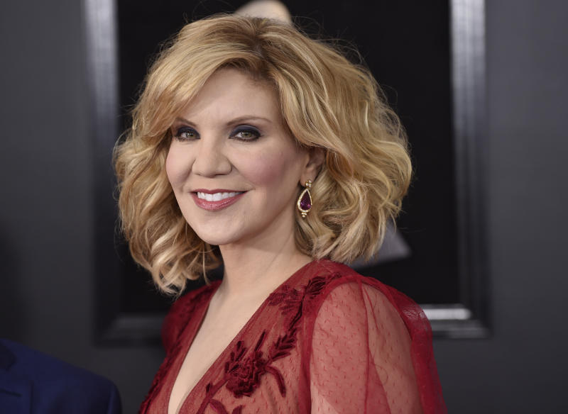 FILE - In this Jan. 28, 2018, file photo, Alison Krauss arrives at the 60th annual Grammy Awards at Madison Square Garden, in New York. Oscar-winning actor Jon Voight, singer and musician Krauss and mystery writer James Patterson are among those being honored by President Donald Trump for their contributions to the arts or the humanities. The White House announced four recipients of the National Medal of Arts and four of the National Humanities Medal Sunday night, Nov. 17, 2019. (Photo by Evan Agostini/Invision/AP, File)
