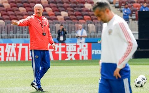 Russia head coach Stanislav Cherchesov (left) observes final preparations - Credit: getty images