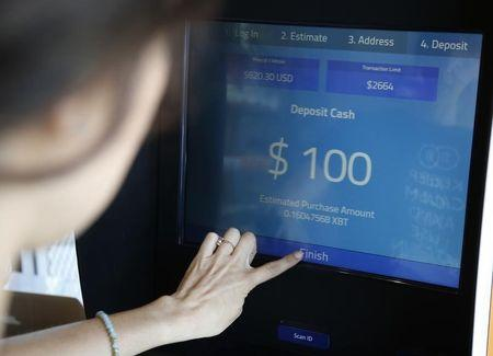 Woman buys bitcoins at one of Southern California's first two bitcoin-to-cash ATMs which began operating today, in Venice, Los Angeles