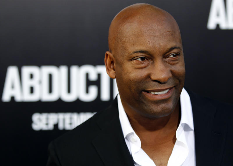 "FILE - In this Sept. 15, 2011 file photo, director John Singleton arrives at the premiere of ""Abduction"" in Los Angeles. Singleton is suing Paramount Pictures and MTV Films for at least $20 million, claiming fraud and breach of contract.  (AP Photo/Matt Sayles, file)"