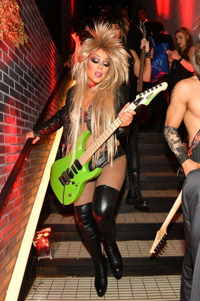 <p>With Tina Turner-esque hair, Carey made a rock n roll show at Heidi Klum's annual halloween party.</p>