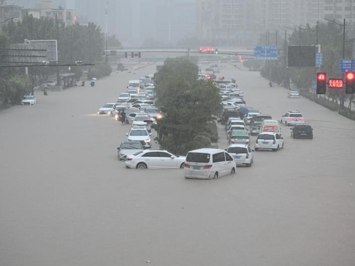 Remarkable videos show commuters in China stuck in waist-deep water in the  subway as heavy flood hits central China, killing at least 12
