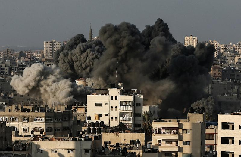 A picture taken on August 9, 2018 shows smoke billowing over Gaza City after an Israeli air strike