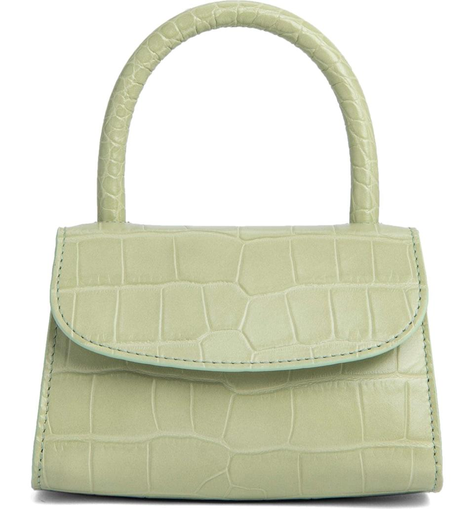 <p>Sign us up for this cute <span>By Far Mini Croc Embossed Leather Top Handle Bag</span> ($562).</p>
