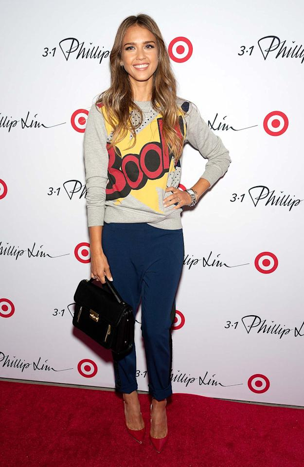 "Jessica Alba was cute as can be upon arriving at the launch party for fashion designer Phillip Lim's latest Target line in New York. Proving that affordable items can be super chic, Jessica posed for photos in this must-have ""Boom"" sweater that retails for $30, along with $40 black-and-blue tuxedo pants. A black handbag and red pumps completed her adorable and accessible ensemble. (9/5/13) Credit: FilmMagic"