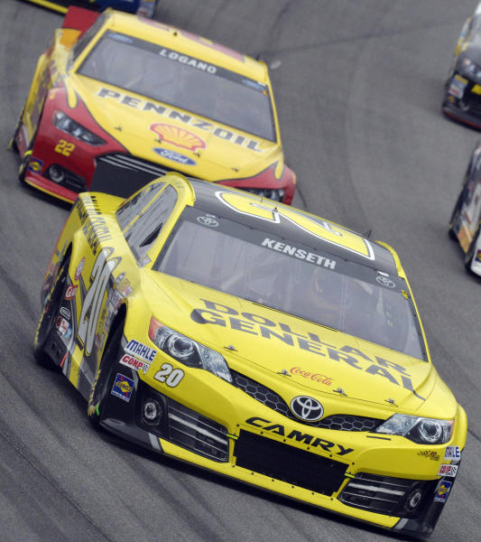 Matt Kenseth (20) drives past Joey Logano (22) during the NASCAR Sprint Cup series auto race at Chicagoland Speedway in Joliet, Ill., Sunday, Sept. 15, 2013. (AP Photo/Warren Wimmer)