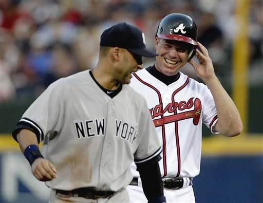 Atlanta Braves' Chipper Jones, right, talks with New York Yankees shortstop Derek Jeter at the end of the third inning of a baseball game in which Jones hit a single, Tuesday, June 12, 2012, in Atlanta. (AP Photo/David Goldman)