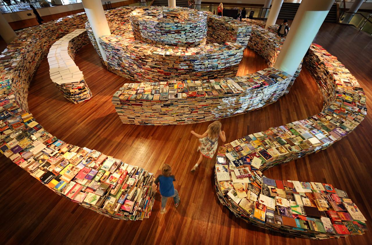 Children play in the 'aMAZEme' labyrinth made from books at The Southbank Centre on July 31, 2012 in London, England. (Photo by Peter Macdiarmid/Getty Images)