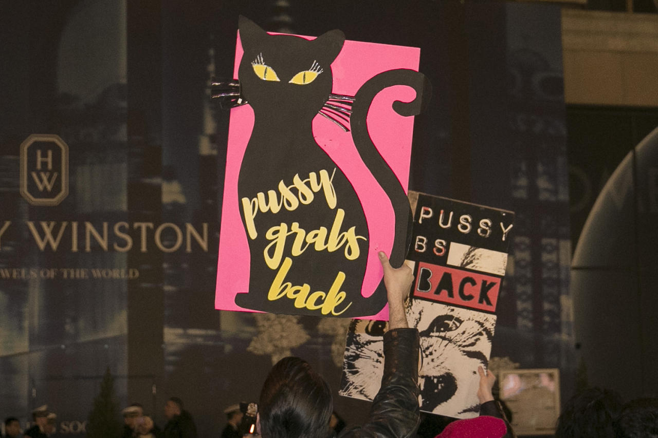 <p>Participants in the Women's March hold signs to protest President Donald J. Trump and his proposed policies in New York City on Jan. 21, 2017. (Photo: Gordon Donovan/Yahoo News) </p>