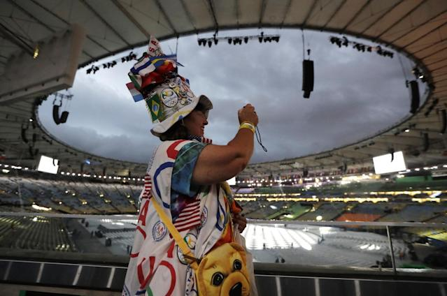 <p>Vivianne Robinson takes photos before the start of the closing ceremony for the Summer Olympics in Rio de Janeiro, Brazil, Sunday, Aug. 21, 2016. (AP Photo/Mark Humphrey) </p>
