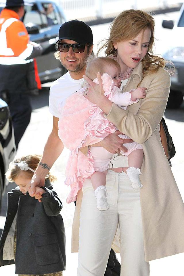 Country singer Keith Urban and Oscar-winning actress Nicole Kidman revealed January 17 that they were the parents of little Faith Margaret Kidman Urban, who was born via surrogate on December 28 in Nashville. She joined sister Sunday Rose, 3, as well as Kidman's children from her marriage to Tom Cruise, Isabella and Connor.    Nicole Kidman, Keith Urban and their kids are all smiles as they depart Sydney. Pictured: Nicole Kidman, Keith Urban, Sunday Rose Kidman Urban and Faith Margaret Kidman Urban Ref: SPL294808 060711  Picture by: Blue Wasp/Grey Wasp/Splash News  Splash News and Pictures  Los Angeles: 310-821-2666  New York: 212-619-2666  London: 870-934-2666  photodesk@splashnews.com