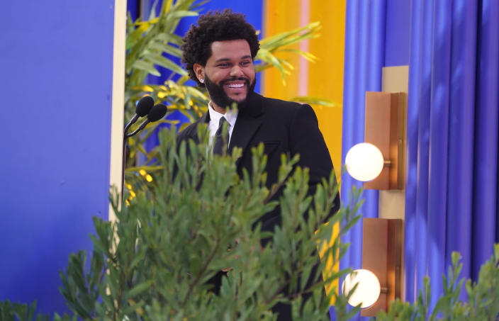 The Weeknd accepts the top hot 100 artist award at the Billboard Music Awards on Sunday, May 23, 2021, at the Microsoft Theater in Los Angeles. (AP Photo/Chris Pizzello)