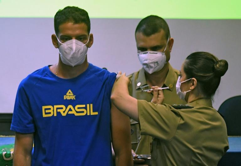 Brazilian bow and arrow athlete Marcus Vinicius D'Almeida is inoculated with a Covid-19 vaccine as part of a project organized by the Brazilian federal government to vaccinate Brazilian citizens accredited to the Tokyo Olympic Games amid the COVID-19 pandemic in Rio de Janeiro state, Brazil, on May 14, 2021